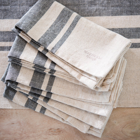 set of four grey and cream cloth napkins