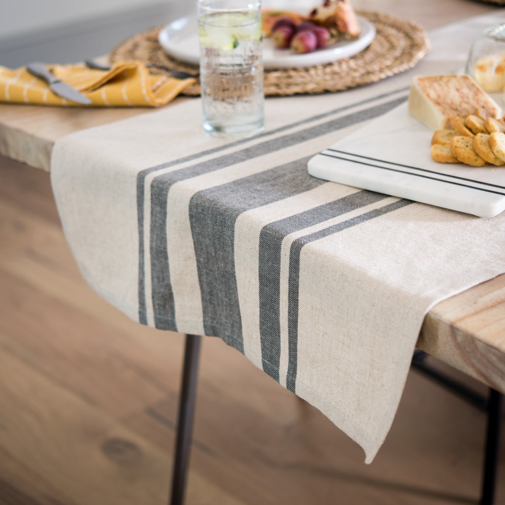 cream table runner with dark grey center stripes