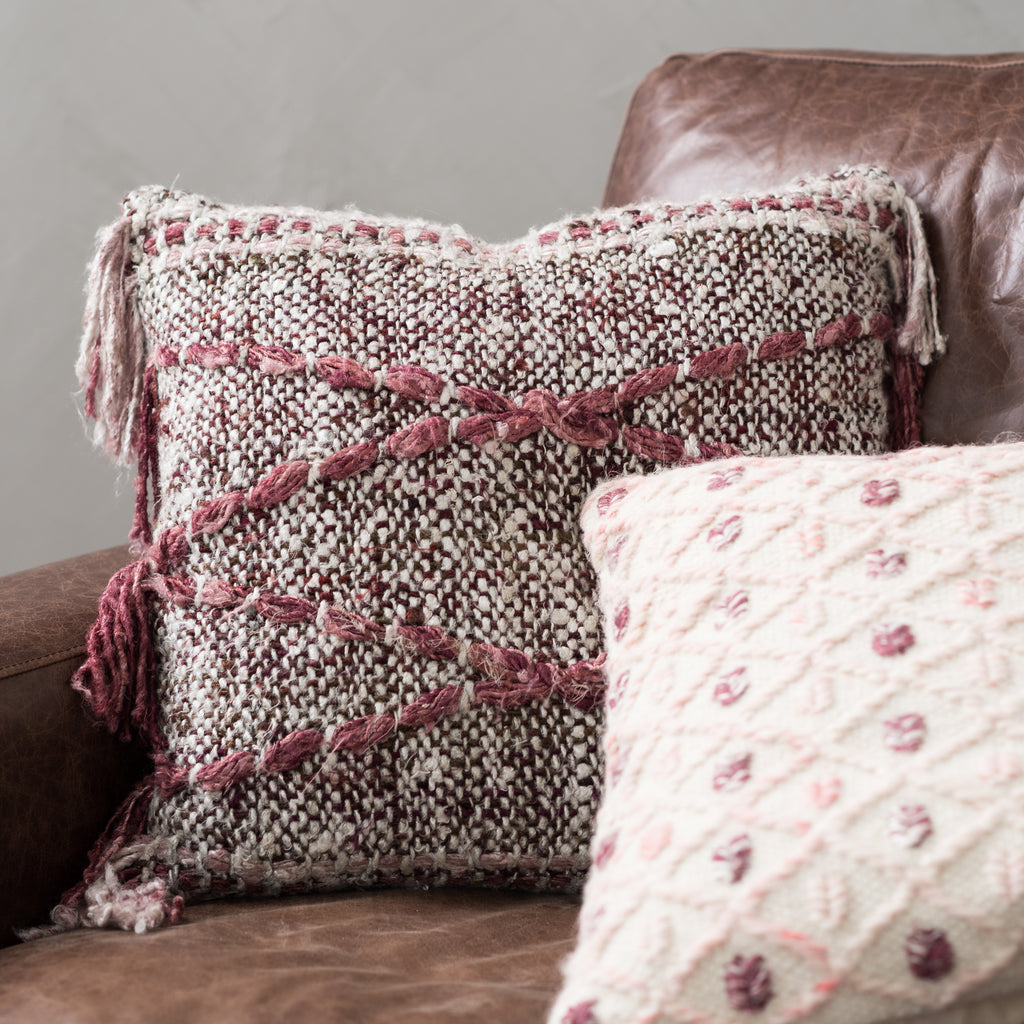 dark grey, burgundy, and cream pillow with tassels