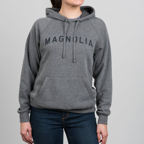 light heather gray hooded sweatshirt with magnolia across chest in dark grey lettering