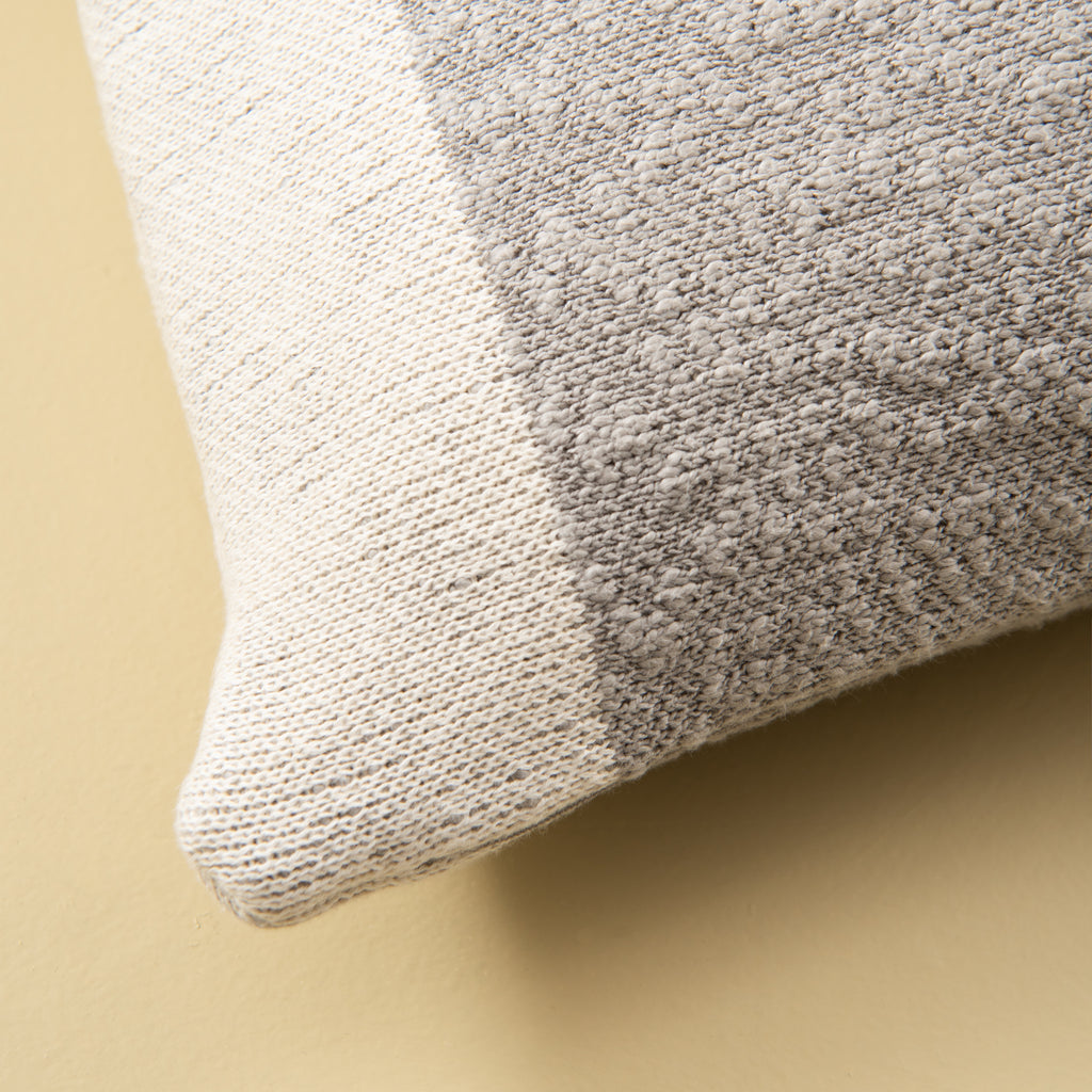 grey and white colorblocked rectangular pillow