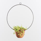 hanging terra cotta pot with metal hanger