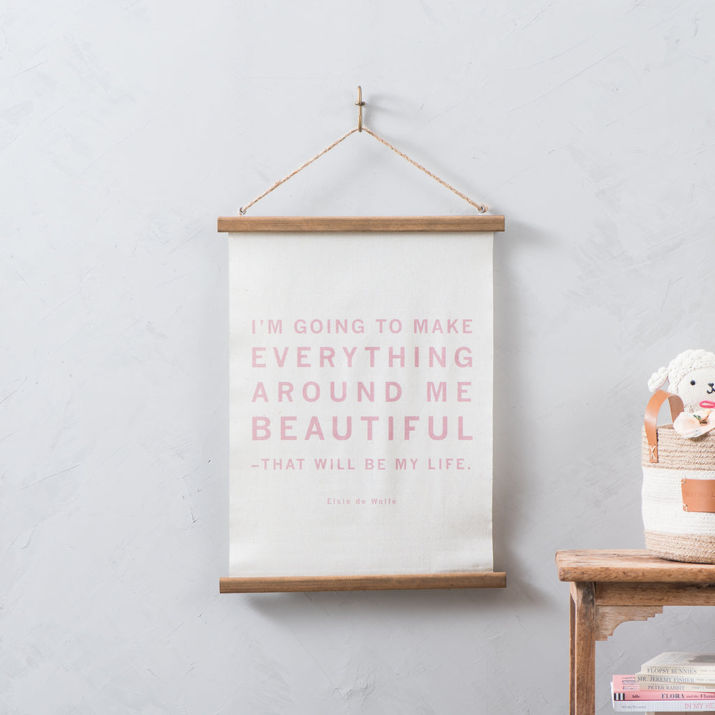 "canvas wall hanging with Elsie de Wolfe quote that reads ""im going to make everything around me beautiful. That will be my life."""