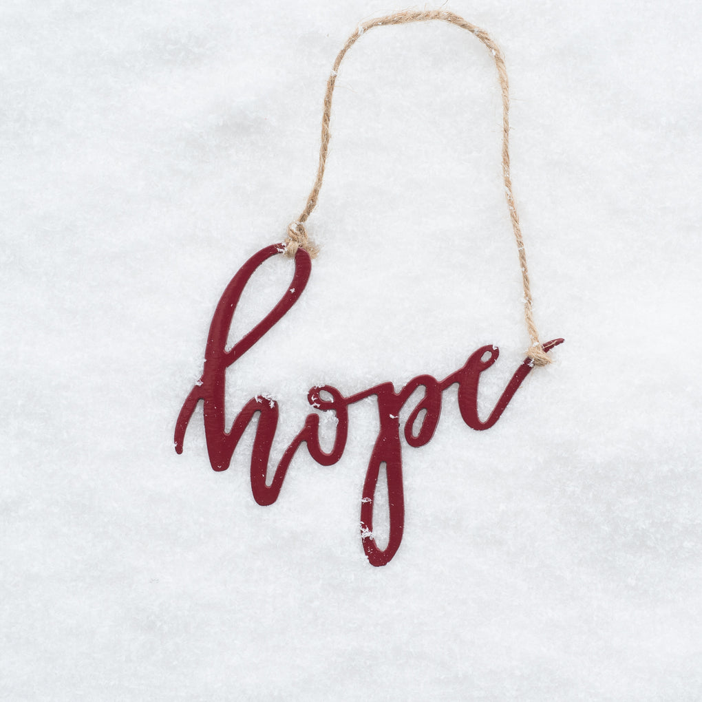 "red script ornament that says ""hope"""