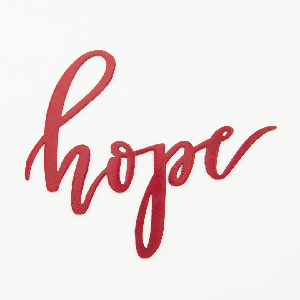 "red script metal wall sign that says ""hope"""