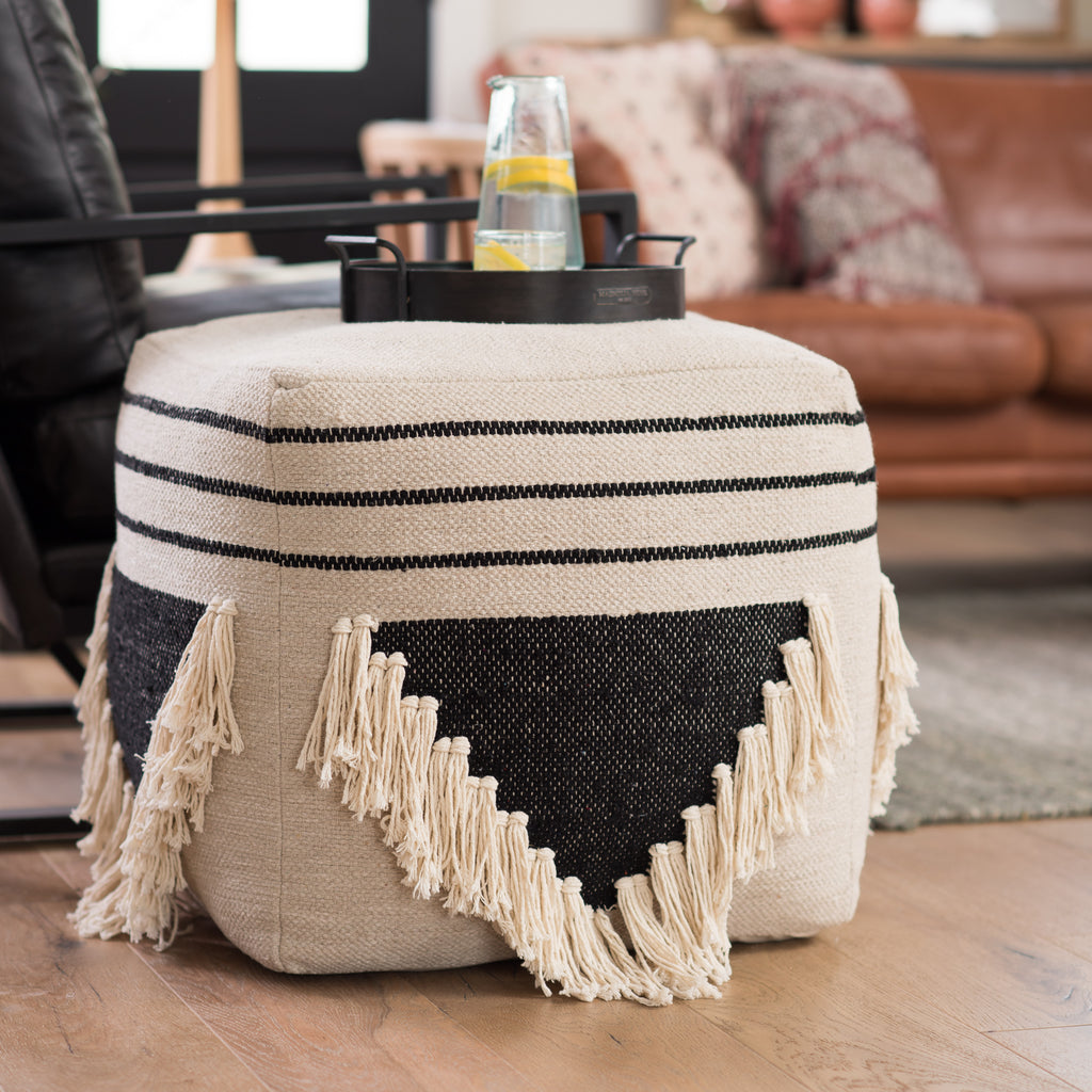 cream and black bohemian style pouf with cream fringe