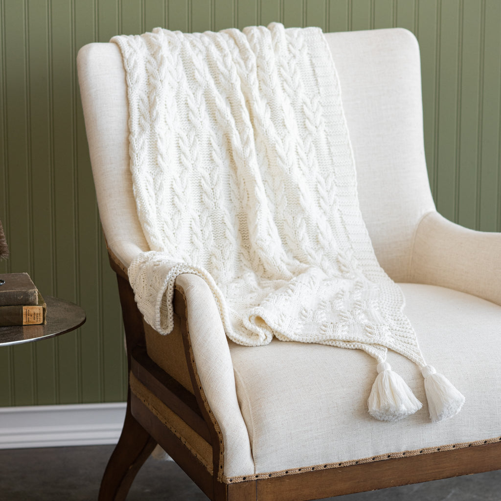 ivory cable knit sweater style throw with tassels