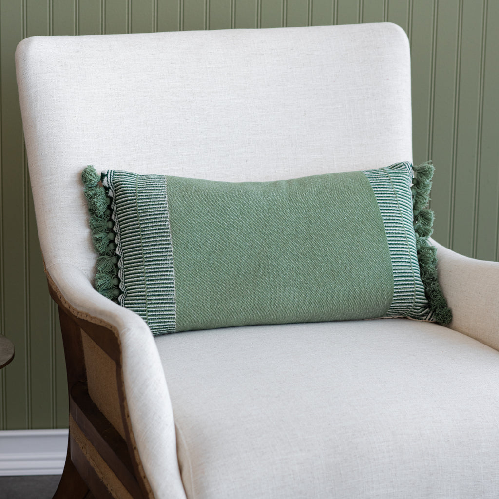 muted green lumbar pillow with tassel fringes