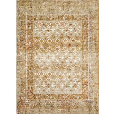 gold and tan distressed area rug with faded geometric detail