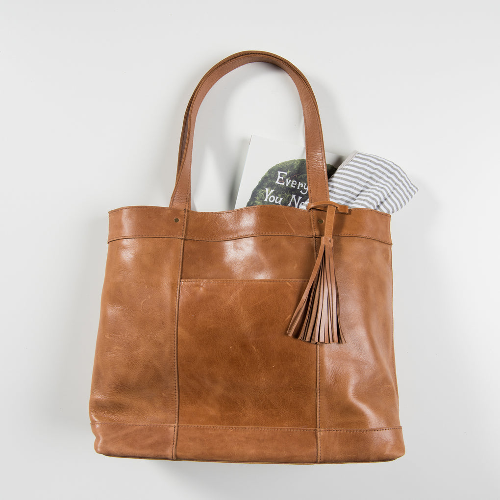 large brown leather diaper bag tote