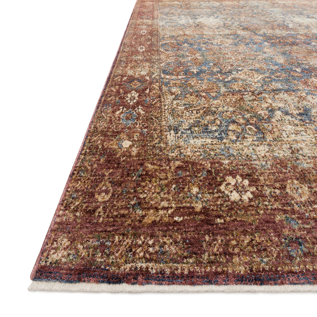 red distressed traditional rug with tan and blue detail