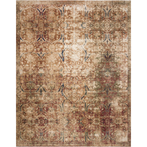 red distressed rug with ornate tan detail