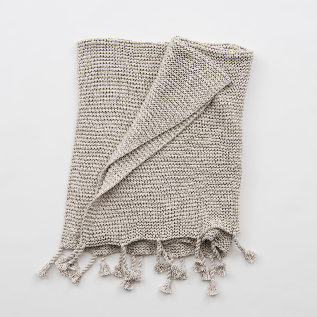 light grey knit throw blanket with tassels