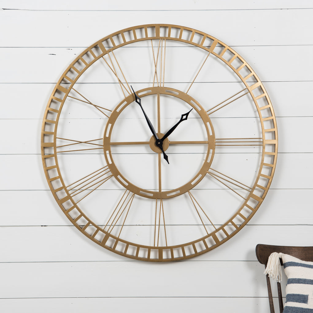 large brass wall clock with roman numeral numbers