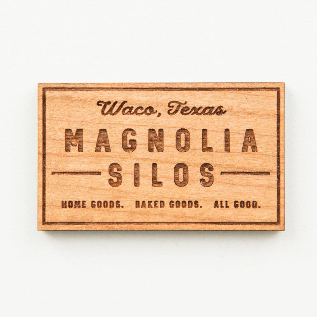 laser engraved wooden magnet with magnolia silos mural logo