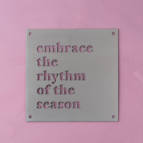 "metal wall sign that reads ""embrace the rhythm of the season"""