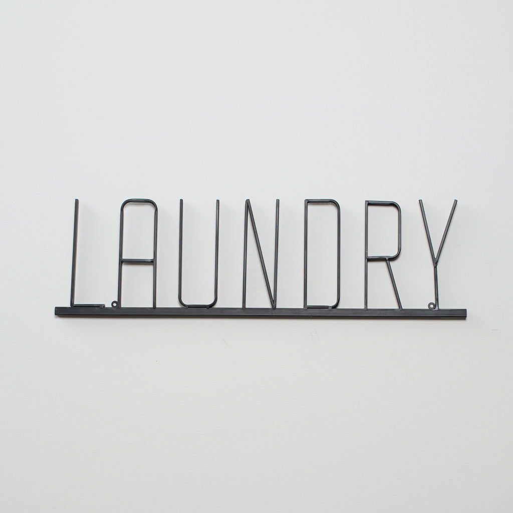 metal laundry sign