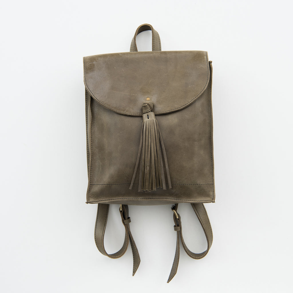 olive leather backpack with tassel