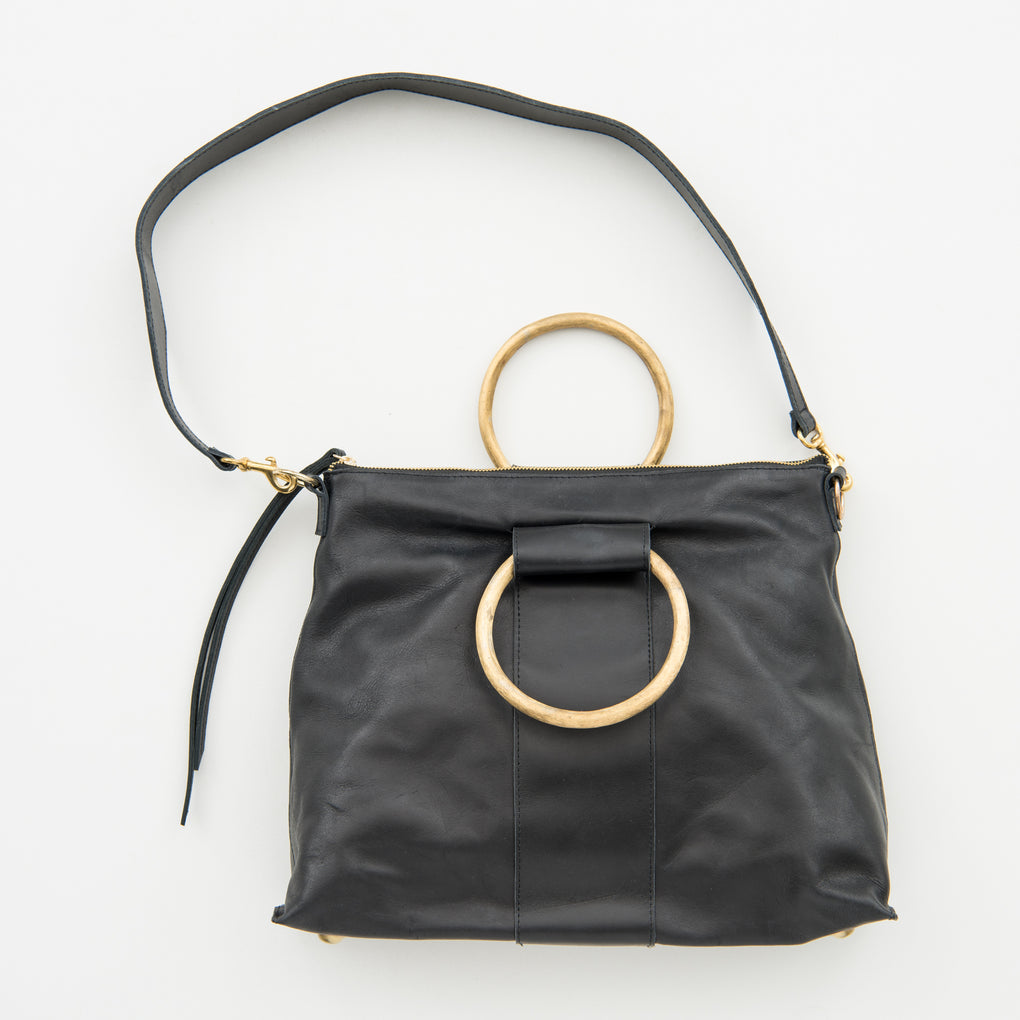 black leather purse with brass ring handle