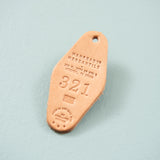 light leather colored key tag keychain