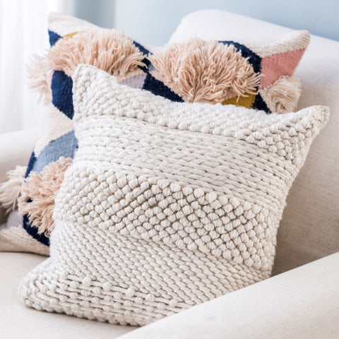 textured light beige pillow with striped pattern