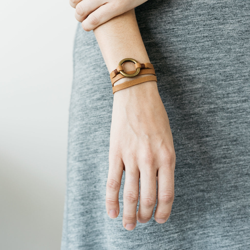light brown leather bracelet with brass ring