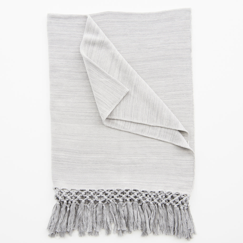 light grey throw with tassels