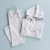 "light grey loungewear set with ""homebody""embroidered on the left chest of the hoodie"