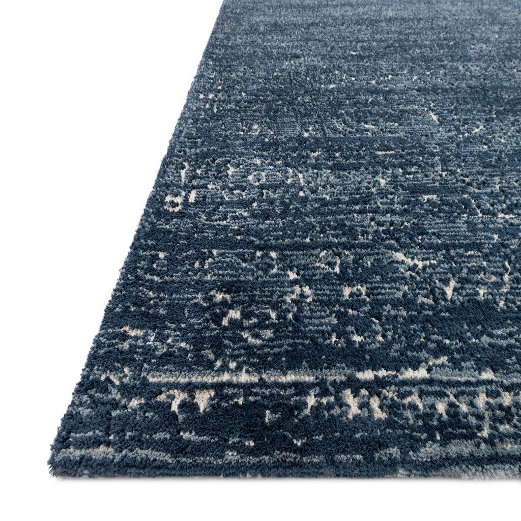 blue rug with cream detail