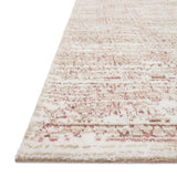 ivory rug with blush pink distressed detail