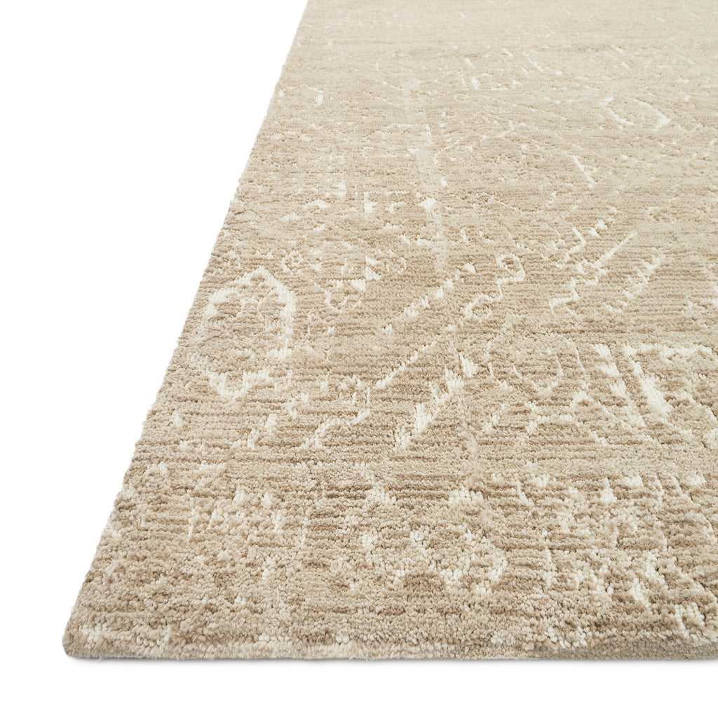 tan colored rug with ivory distressed detail