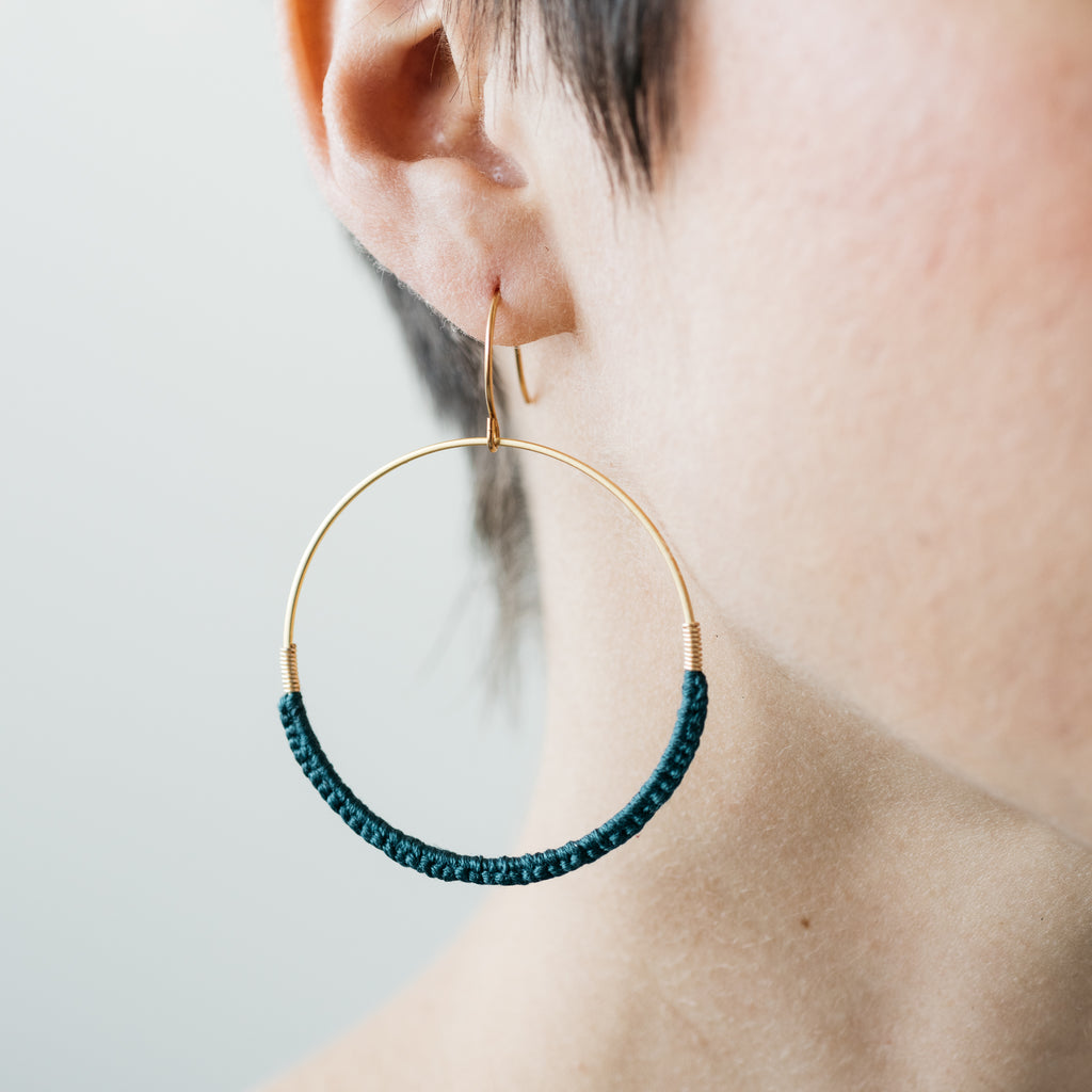 gold hoop earrings with teal cotton thread