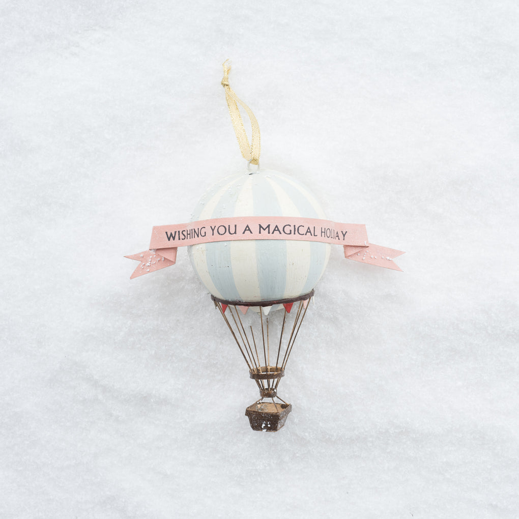 "hot air balloon ornament with a ribbon saying ""have a magical holiday"""