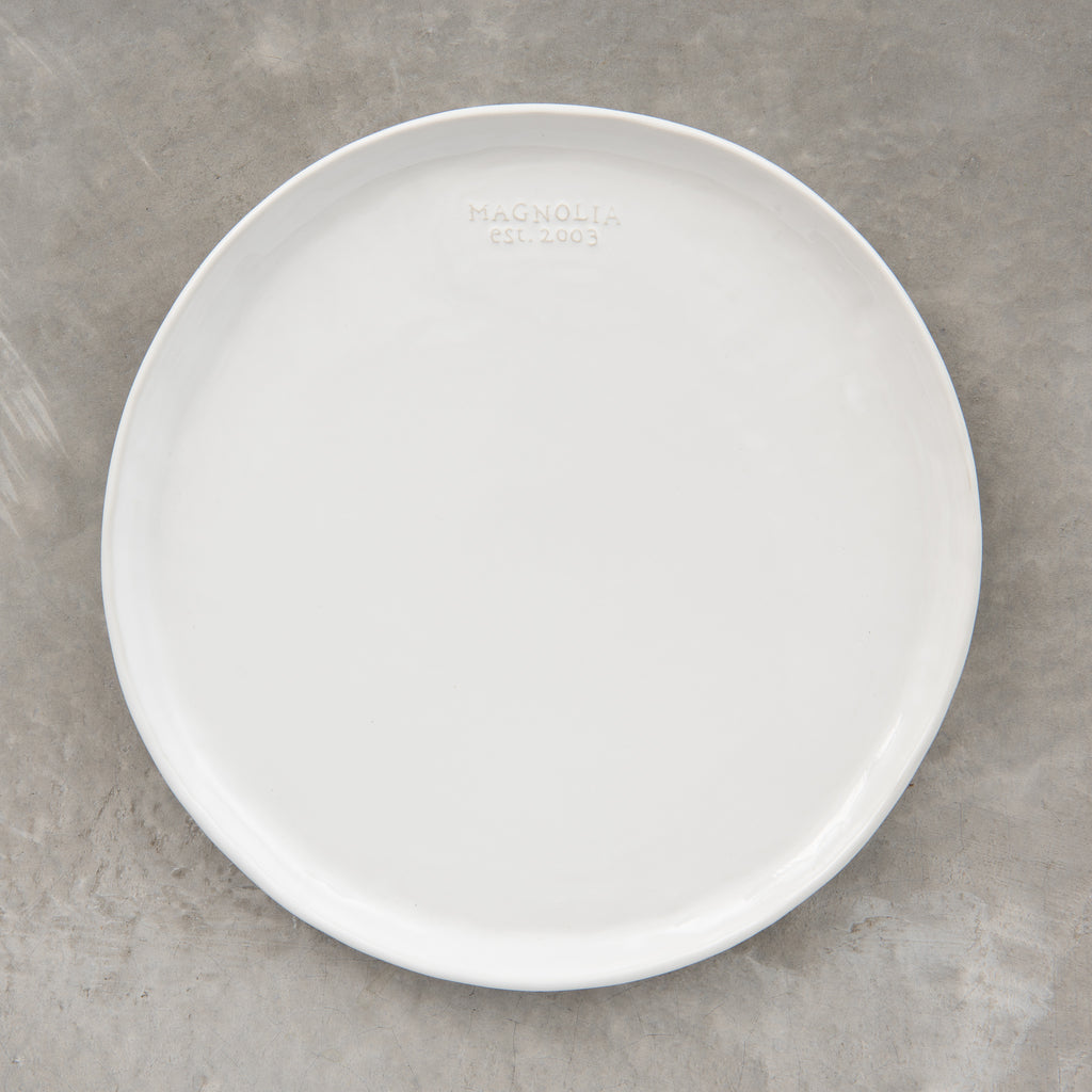 dinner plate with magnolia logo embossing