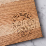 white oak cutting board with magnolia silos seal