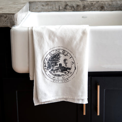 white tea towel with original magnolia farms seal in black