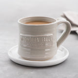 handthrown ceramic coffee mug with magnolia table logo stamp