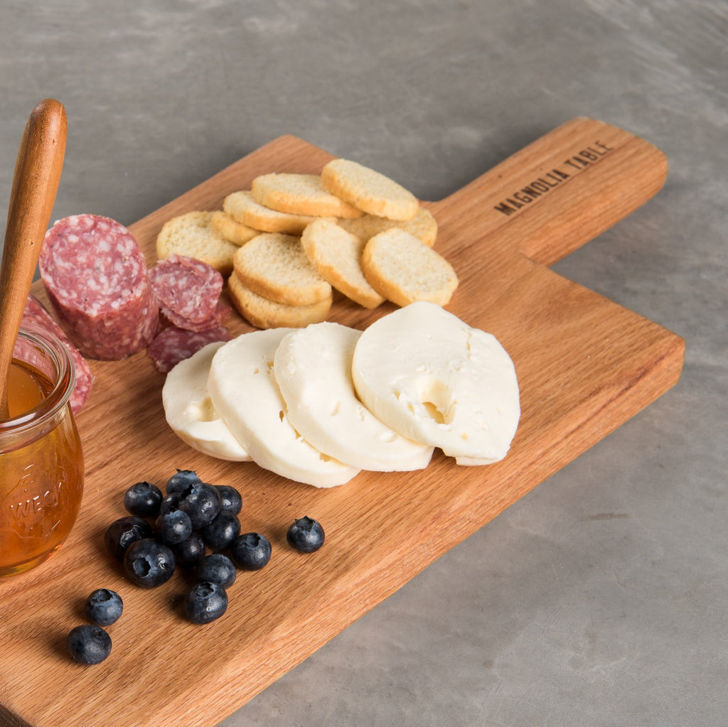 rectangular oak serving board with magnolia table brand logo
