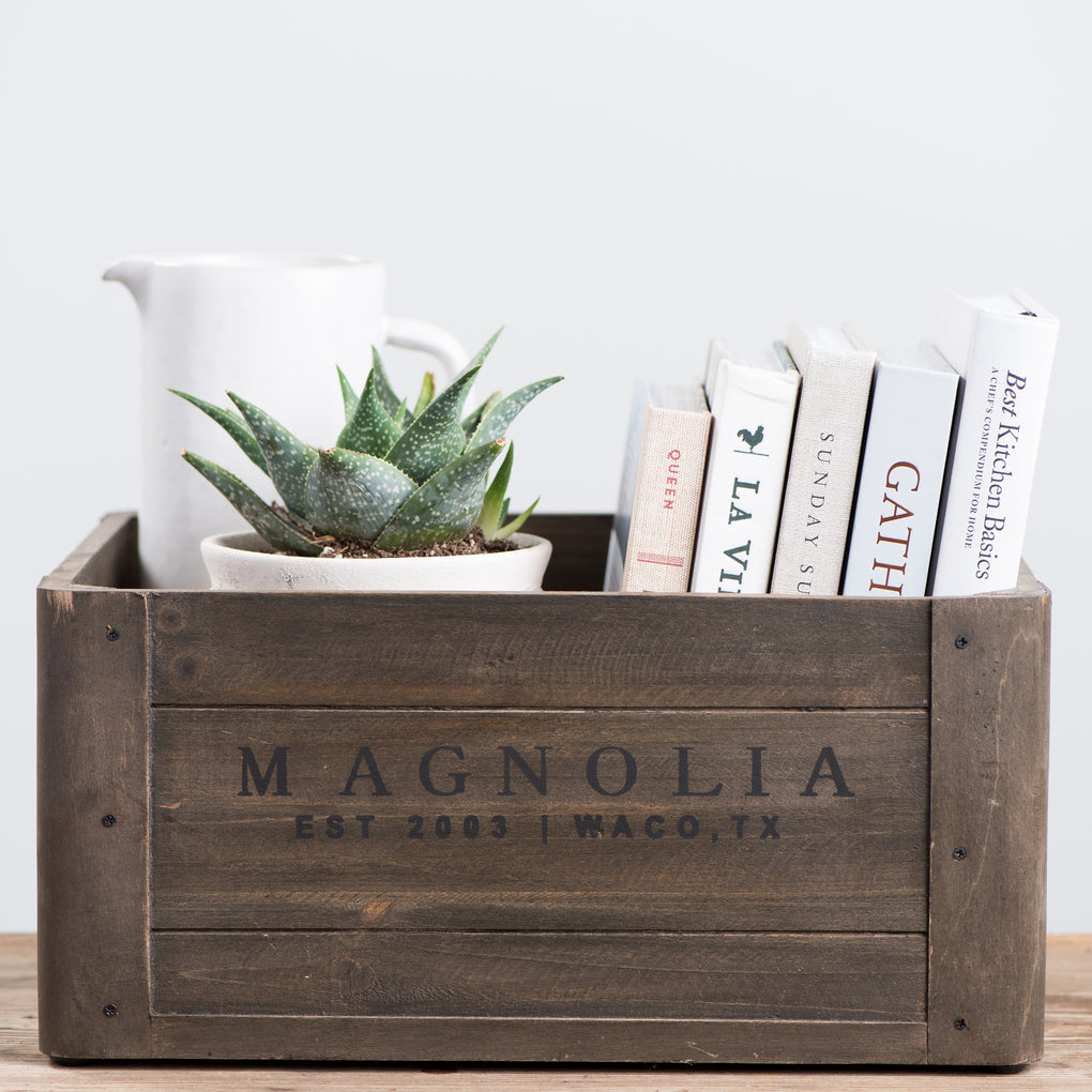 wooden crate with magnolia logo