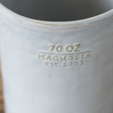 large 70 ounce white ceramic pitcher with handle and embossed Magnolia Established logo