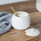 white ceramic sugar bowl with lid with magnolia established logo