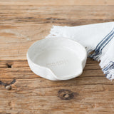 white ceramic spoon rest with magnolia established logo