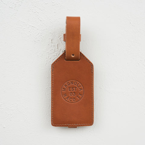 leather luggage tag with magnolia circle logo
