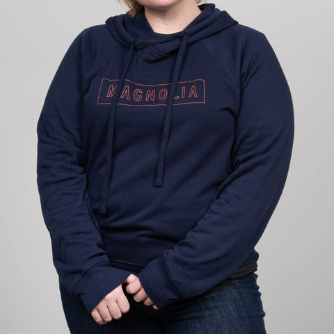 navy blue crossover hoodie with orange magnolia outlined logo