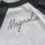 grey and black baseball tee style baby bodysuit with magnolia script logo