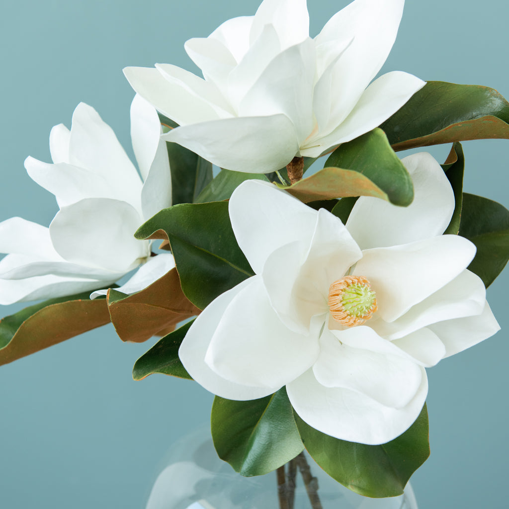 faux magnolia stem with bloomed magnolia flower