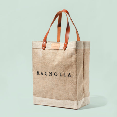 natural colored canvas market tote with magnolia logo on side