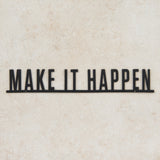 "black metal wall expression that reads ""make it happen"""