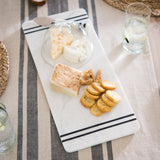 white marble cutting board with glass dome