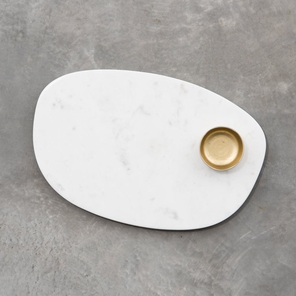 marble serving board with brass dish
